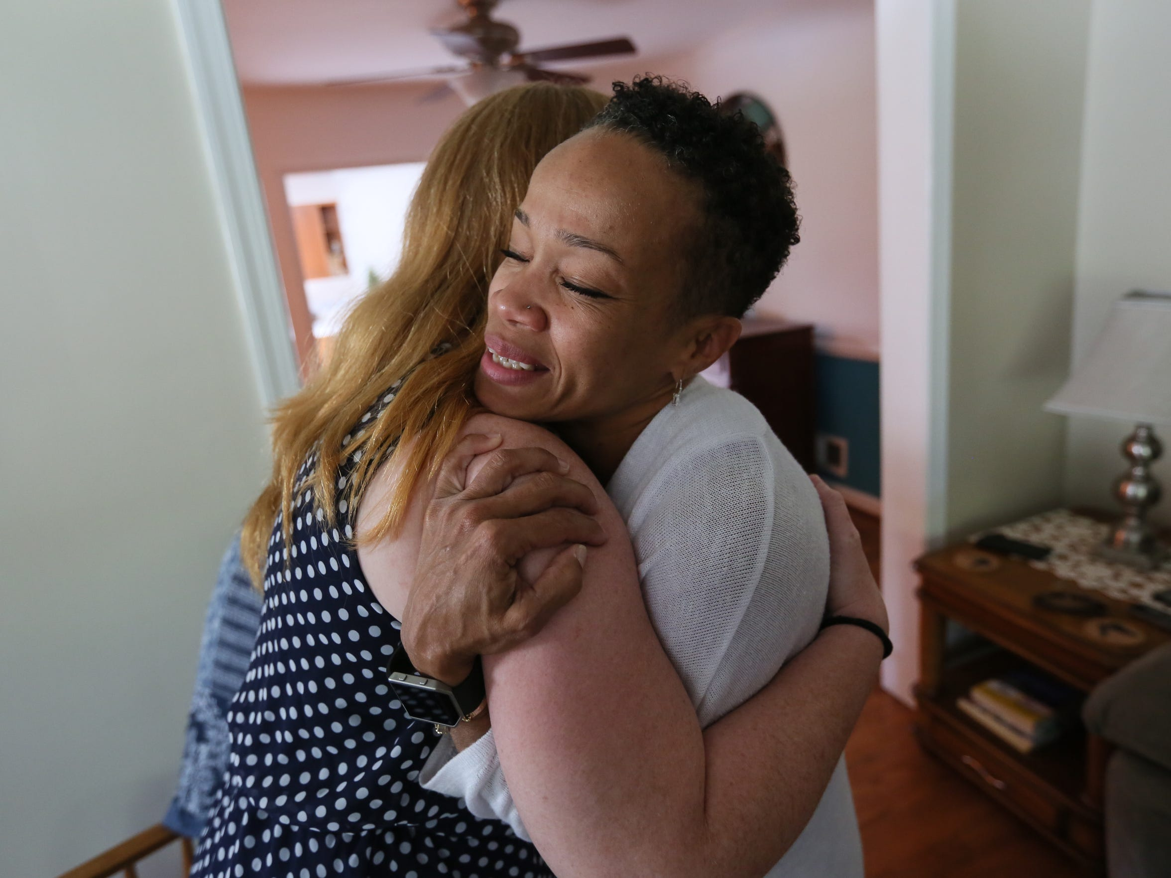 Karen Harris (right), director of Kim's Place, a new sober living home in Elsmere, gives a hug to Samantha, who wanted only her first name used. Samantha is staying in the house during her journey to recovery.