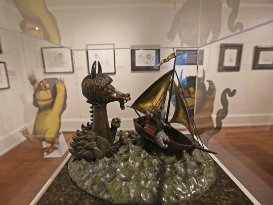 A bronze sculpture of Max and the Sea Monster in the exhibit for Maurice Sendak at the Biggs Museum of American Art.