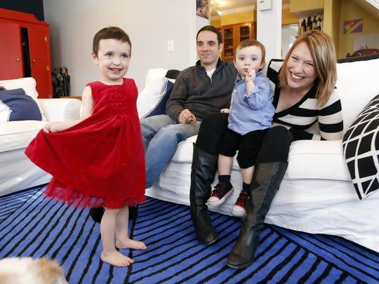Greg Santini and his wife Heather Carmichael-Santini,