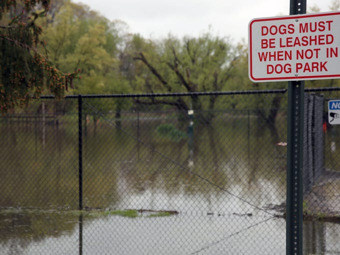 The rising waters of Irondequoit Creek caused flooding