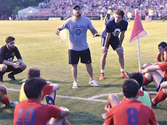 Oakland soccer coach Jeff Porter talks to his troops during last week's district finals. The Patriots will be at Franklin County Tuesday in the Region 4-AAA semifinals.