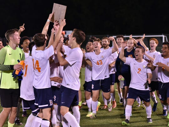 Blackman players celebrate their 1-0 win over Oakland