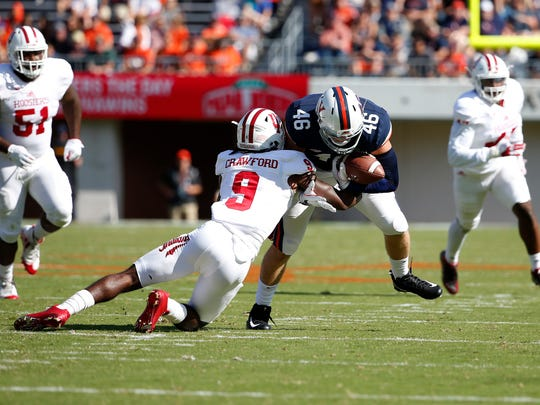 Virginia Cavaliers tight end Evan Butts (46) carries the ball as Indiana Hoosiers defensive back Jonathan Crawford (9) defends during the first quarter at Scott Stadium.