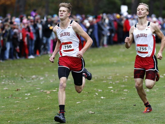 Valders runners Cody Meyer, left, and Trevor Wenzel run to the finish line during the WIAA Division 2 State Cross Country Championships on Saturday in Wisconsin Rapids.