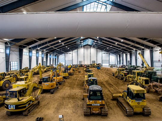 An indoor warehouse holds dozens of machines at the