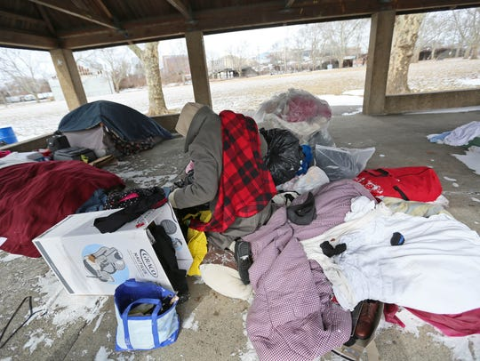 A homeless man in a makeshift camp in Christina Park endures single-digit temperatures in this 2015 file photo.