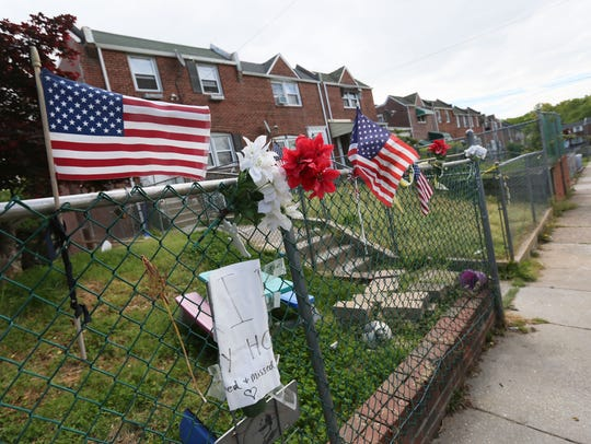 A memorial along the fence of the row home on Lakeview