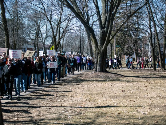 Protesters march to Old Main for a demonstration and