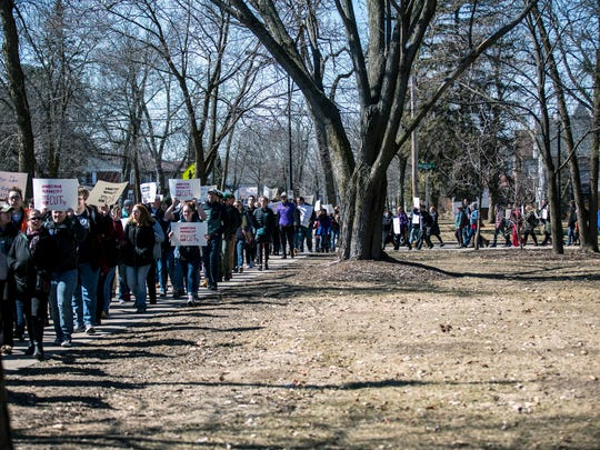 Protesters march to Old Main for a demonstration and sit-in to protest a proposal to cut 13 liberal arts majors at the University of Wisconsin-Stevens Point in Stevens Point, Wis., Wednesday, March 21, 2018.