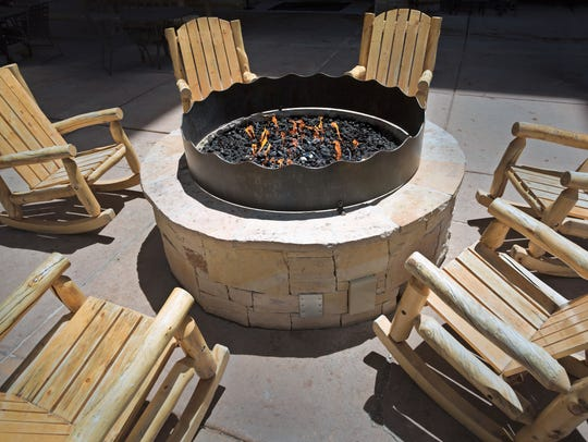 A backyard fire pit can be fueled by sources including