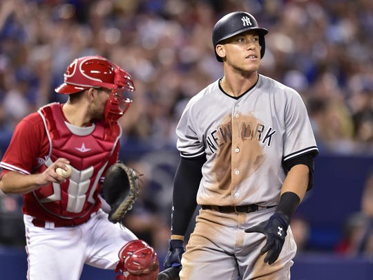 Frank Gunn AP The Yankees' Aaron Judge, right, reacts