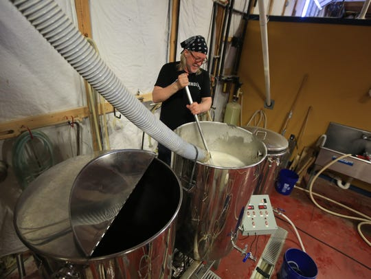 Rob Pfeiffer, a brewer at Smyrna's Blue Earl, prepares