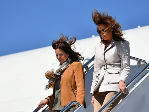 It was gusty weather when first lady Melania Trump and second lady Karen Pence arrived at Fort Bragg in North Carolina on April 15, 2019, for a joint visit to a military base. They will tour the special-operations base to learn more about the training of elite troops, and also plan to visit a middle school on the base.