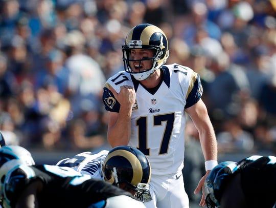 Los Angeles Rams quarterback Case Keenum yells to his
