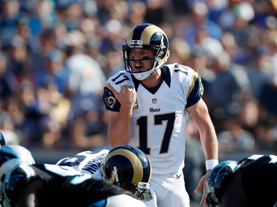 Los Angeles Rams quarterback Case Keenum yells to his team during the first half of an NFL football game against the Carolina Panthers, Sunday, Nov. 6, 2016, in Los Angeles.