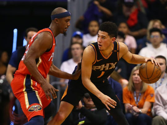 Suns guard Devin Booker (right) had another poor shooting
