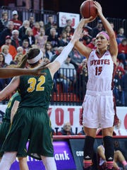 USD's Kelly Stewart takes a shot over NDSU's Marena