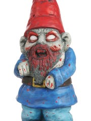 Zombie Gnome garden sculptures add a comical twist to outdoor decor.