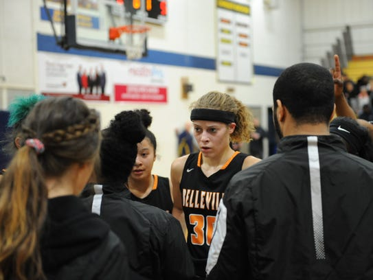 During a timeout, Belleville's Katelyn Sherwood and teammates listen to instructions from coach Mariah Gordon.