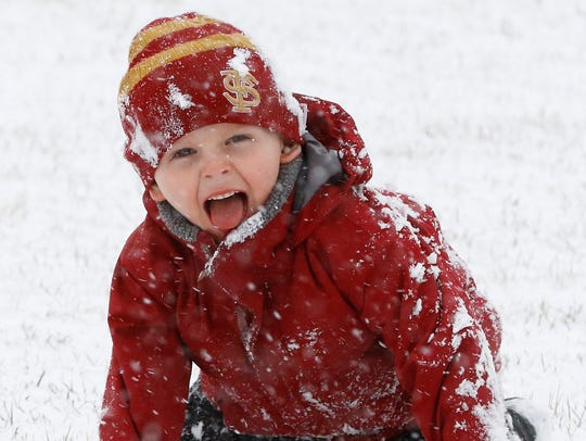 Gavin Lynd, 4, of Weston, plays with the snow Wednesday