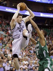 Utah Jazz's Jack Cooley (45) pulls down rebound in front of Boston Celtics' Jordan Mickey (55) during the second half of an NBA summer league basketball game on Monday. The Jazz won 100-82.