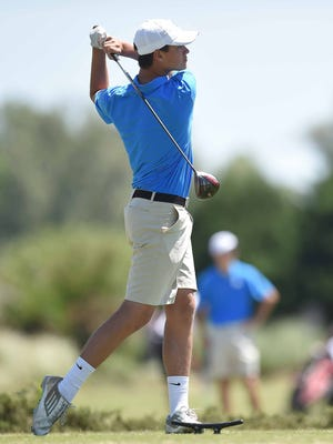 Madison Central's Jacob School follows through on his tee shot on Thursday, May 5, 2016, in the MHSAA State Golf Tournament at the Lake Caroline Golf Club in Gluckstadt, Miss.