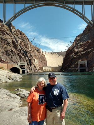 Sherry and Chuck Trickey Grosse Pointe Woods in Black Canyon along the Colorado River in Nevada. Hoover Dam is in the background.