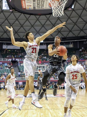 Miles Bridges of the Michigan State Spartans looks to shoot the ball around Chance Comanche of the Arizona Wildcats during the first half of the Armed Forces Classic at the Stan Sheriff Center on Nov. 11, 2016 in Honolulu, Hawaii.