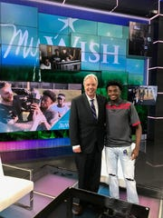 """Mount Juliet's Jalan Sowell with ESPN's """"My Wish"""" host  host Chris Connelly."""