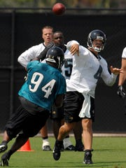 Jacksonville Jaguars quarterback Todd Bouman (4) gets off a pass as defensive end Jeremy Mincey (94) rushes during an off-season on-field football practice session Tuesday morning, June 3, 2008, at the practice fields adjacent to Jacksonville Municipal Stadium in Jacksonville, Fla. (AP Photo/The Florida Times-Union, Rick Wilson) ** MAGS OUT, TV OUT **