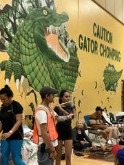 Maria Tovar, a 10th grade student who evacuated to Island Coast High School for Hurricane Irma, entertains people with her flute.