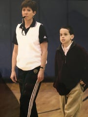 Notre Dame coach Muffet McGraw and her son, Murphy, at an Irish practice in 2001, when Murphy was 10. Photo courtesy of Muffet and Matt McGraw.