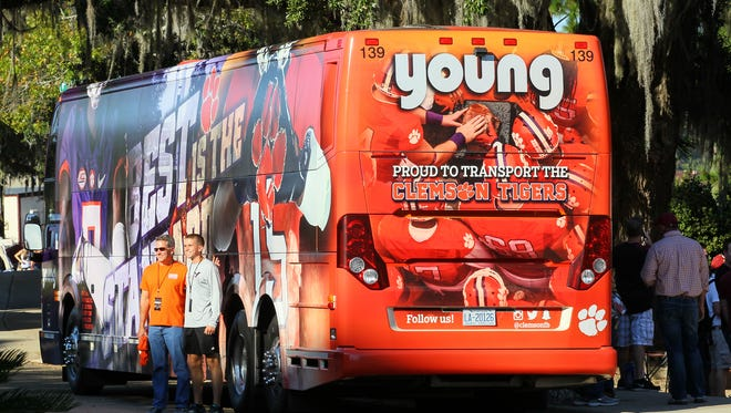 Fans stand by a Clemson bus before kickoff on Saturday October 29 at Doak Campbell Stadium in Tallahassee, Florida.