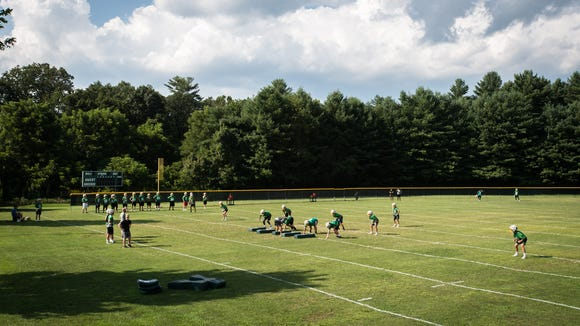 The Christ School football team practices Aug. 22.