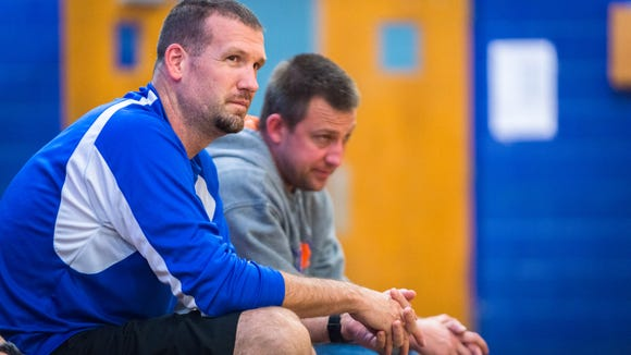 Joey Bryson, the West Henderson basketball coach, watches as athletes scrimmage during after school conditioning Oct. 19.