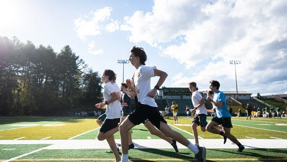 The AC Reynolds High School cross-country team works out during practice Oct. 24.