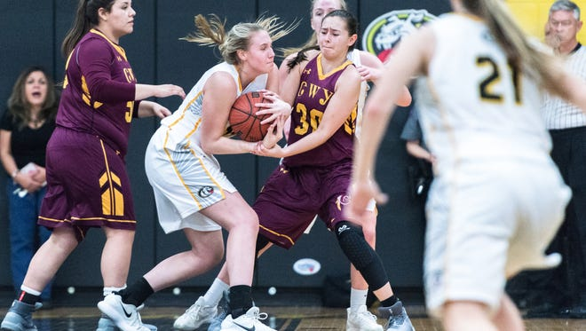Murphy's Jessica Beckner fights for the ball with Cherokee's Tori Teesateskie during their game Tuesday, February 27, 2018. Murphy defeated Cherokee 55-32.