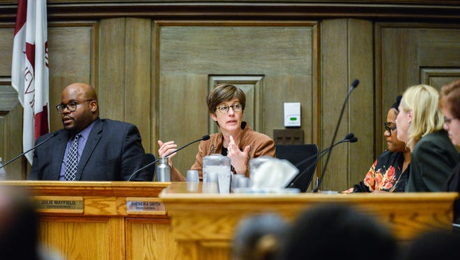 Councilwoman Julie Mayfield speaks at an Asheville City Council meeting Tuesday March 20, 2018.