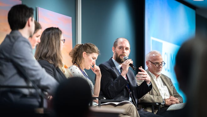 Jeremy Tarr, the policy adviser for North Carolina Gov. Roy Cooper's office, speaks on the We Are Still In regional panel at the 2018 Climate Con held March 21 at the Collider in Asheville.