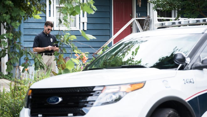 An Asheville police officer on scene on South French Broad Avenue by the A-B Tech campus after a report of a shooting in the Erskine-Walton apartments around 10:30 am Tuesday morning, July 24, 2018. A-B Tech and Asheville high school and SILSA were on lockdown until about 11:30.