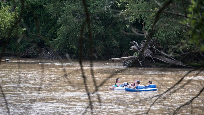 Tubers float down the French Broad River.
