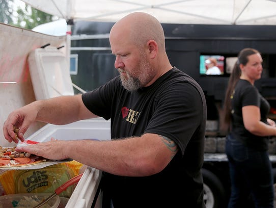 Dan Prasch of Mad Moose Pizza's creates a pizza as