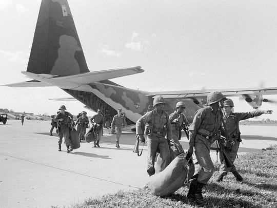 Federal troops land in Selfridge Field, Michigan after President Johnson ordered them to help quell race riots in Detroit, July 24, 1967.  About 5,000 troops were called in.