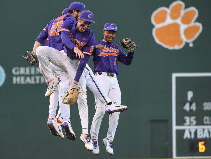 Clemson players celebrate a 5-1 win over South Carolina
