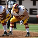 September 29, 2013; Oakland, CA, USA; Washington Redskins center Will Montgomery (63) snaps the football against the Oakland Raiders during the first quarter at O.co Coliseum. The Redskins defeated the Raiders 24-14. Mandatory Credit: Kyle Terada-USA TODAY Sports