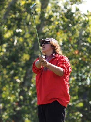Piketon's D.J. Graham tees off on the 12th hole during the Division II state tournament at Ohio State's Scarlet Course.