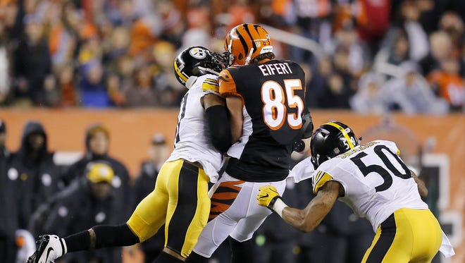 Cincinnati Bengals tight end Tyler Eifert is hit high by Pittsburgh Steelers cornerback Antwon Blake (41) and inside linebacker Ryan Shazier (50) on a reception in the first quarter on Saturday.