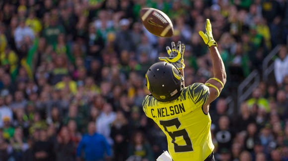 Oct 29, 2016; Eugene, OR, USA; Oregon Ducks wide receiver Charles Nelson (6) catches the ball for a touchdown against the Arizona State Sun Devils during the first quarter at Autzen Stadium. Mandatory Credit: Cole Elsasser-USA TODAY Sports