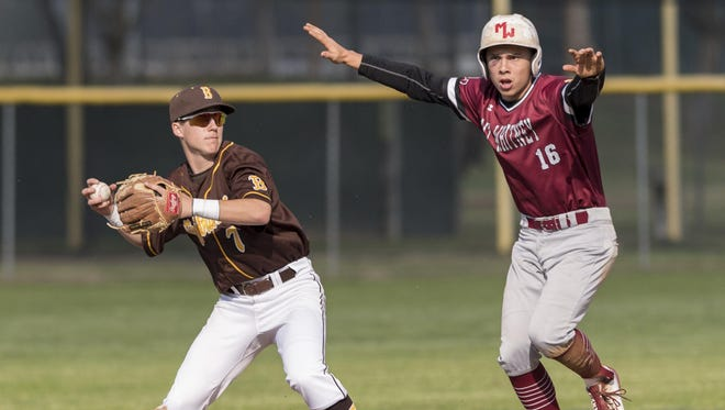 Mt. Whitney's Matthew Rodriguez arrives at second as Golden West's Payton Allen looks to first during a West Yosemite League high school boys baseball game on Thursday, March 23, 2017.