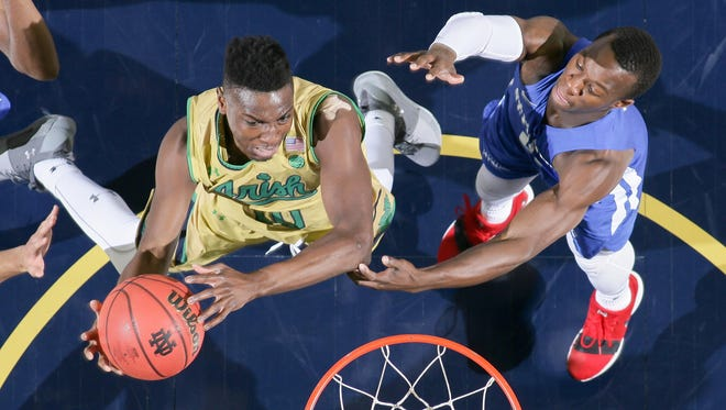 Notre Dame Fighting Irish guard T.J. Gibbs (10) shoots as Saint Francis Terriers guard Rahseem Dunn (0) defends in the second half at the Purcell Pavilion.